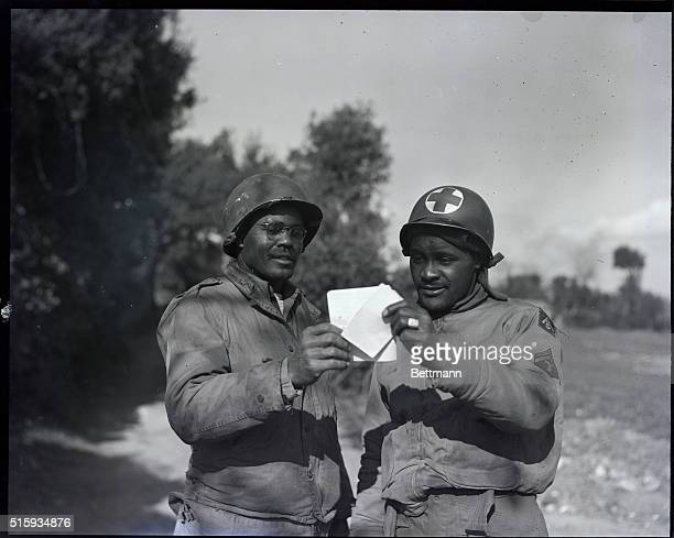 Greater love hath no man than that he share his mail from home with his buddy Pfc James Lang of Carrolton AL and Jerome Taggart of Philadelphia are...