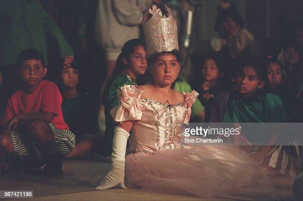 Jefferson Elementary School student Vanessa Ramirez who is playing Glenda the Good Witch and other young actors watch a run–through of The Wizard of...