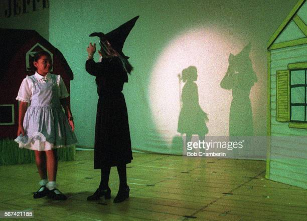 Jefferson Elementary School students Marjorie Mejia and Sandy Espana chat before run–through of The Wizard of Oz' in the cafeteria in Lennox on...