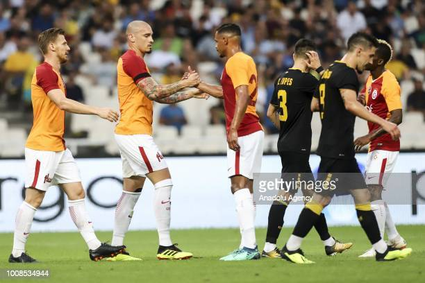 Players of Galatasaray celebrate their goal against AEK Athens during friendly football game between AEK Athens and Galatasaray in OAKA Stadium in...