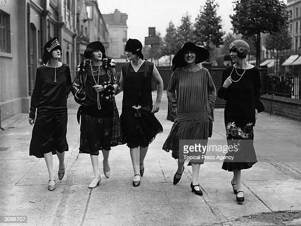 Models outside the fashion exhibition at Holland Park in London wearing comtemporary dropped waist dresses and styles of 25 years ago