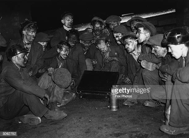Miners in Tony Pandy in Wales waiting to hear the result of the Tommy Farr boxing match