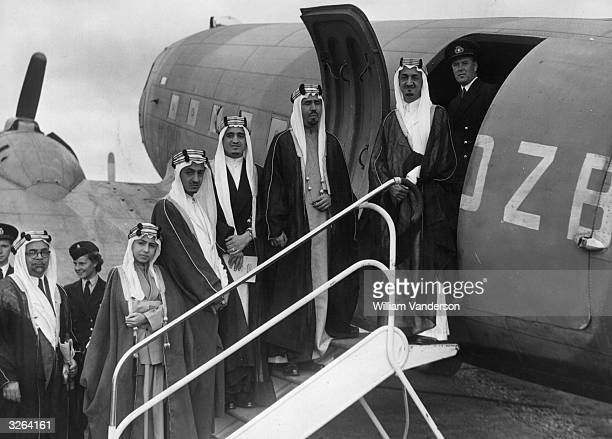 Five sons of King Abdul Aziz Ibn Saud of Saudi Arabia board a plane at Herne Airport in Hampshire They are the Amir Faisal Amir Mohammed Amir Fahd...