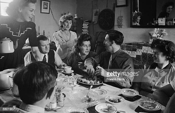 US soldier Sergeant Fournier dining with the family of his English bride before setting sail for America Original Publication Picture Post 2091 Two...