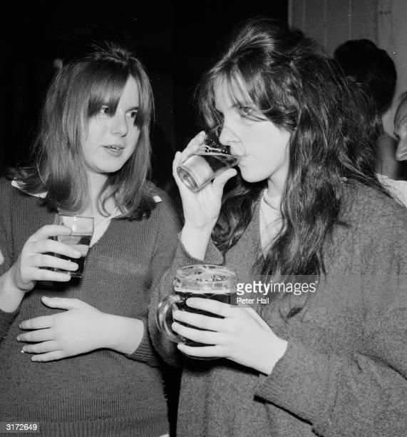 Marian Dawson and her friend Kathleen Mayo stick to nonalcoholic apple juice at a rave on Eel Pie Island Twickenham Surrey Sixteenyearold Kathleen...