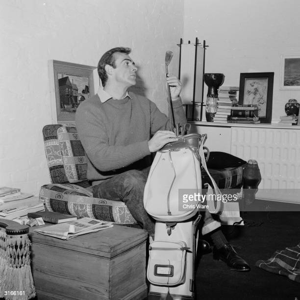 Scottish actor Sean Connery the new face of superspy James Bond prepares for a game of golf at his basement flat in London's NW8