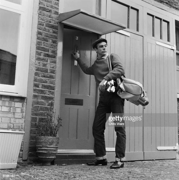 Scottish actor Sean Connery the new face of superspy James Bond leaves his basement flat in London's NW8 for a game of golf his favourite pastime