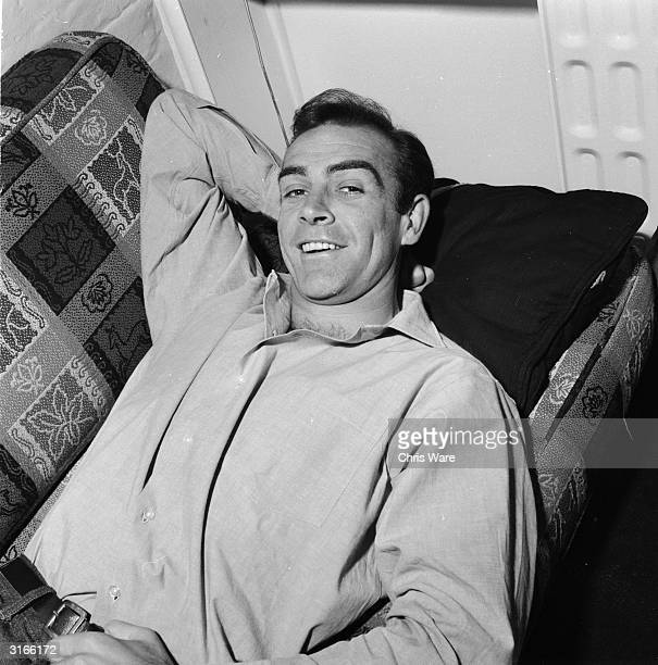 Scottish actor Sean Connery the new face of superspy James Bond relaxes in his basement flat in London's NW8