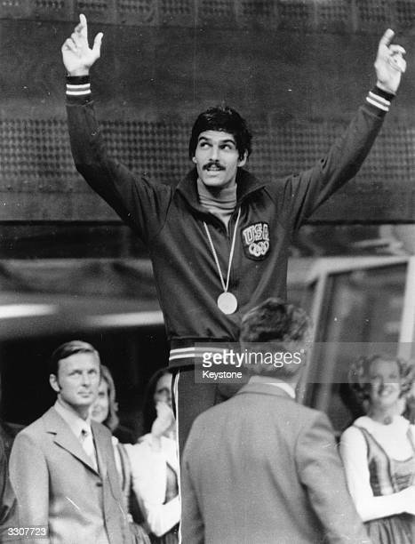 American swimmer Mark Spitz celebrates winning his fifth gold medal in the 100 metres butterfly at the 1972 Munich Olympics