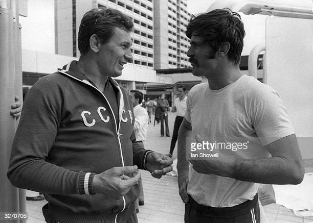 Wrestlers Alexander Medvjed of Russia and Hank Schenk of the USA talking in the Olympic Village at Munich during the Games