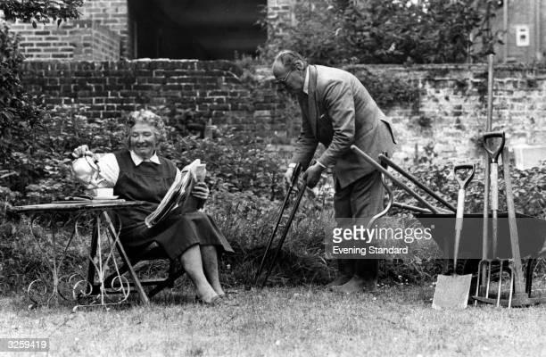 Mrs B Robertson and Mr R Marbatt share the toils of gardening