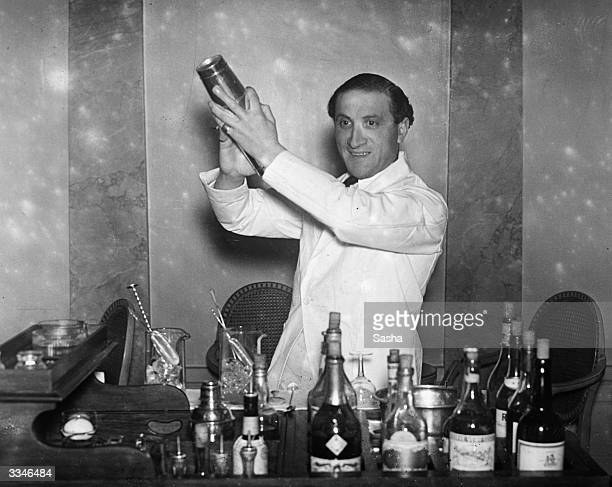 Barman on duty at the cocktail bar of Hector's Devonshire Restaurant in London on New Years Eve is seen preparing a cocktail. Shaken not stirred.