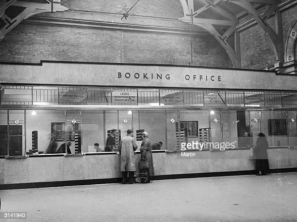 Clerks selling tickets at the new London and NorthEastern Railway booking office at York Station
