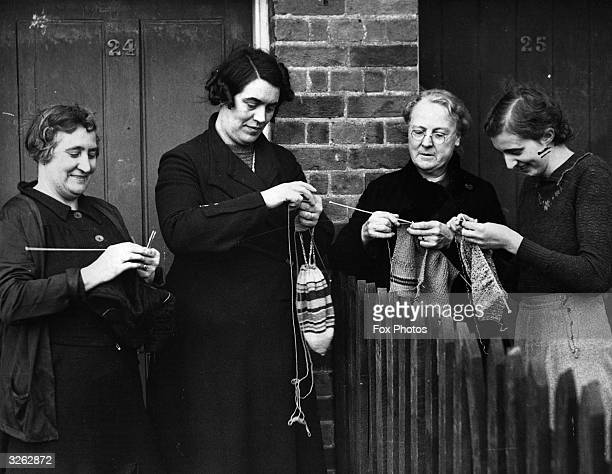 A group of women in Bayford Herfordshire knitting warm clothing for the young London evacuees now living in their village