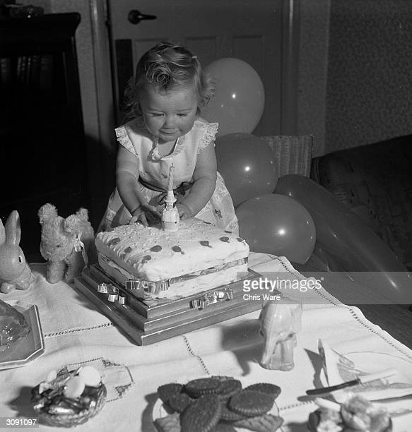 Margaret Harding blowing the candle on her first birthday cake