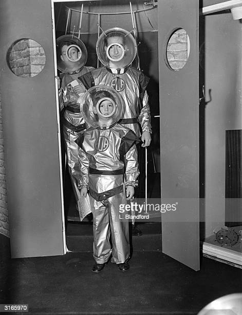 Former King Peter of Yugoslavia and his son Prince Alexander wearing space suits as they emerge from the 'Wheel Of Time' at the Schoolboys Own...