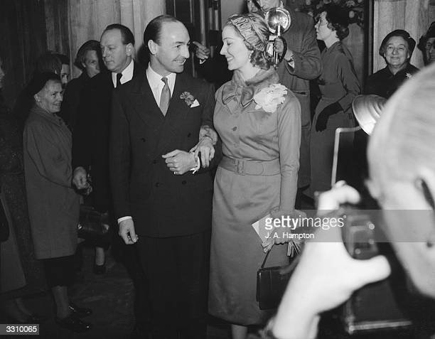 Conservative MP John Profumo and stage and screen actress Valerie Hobson are photographed as they leave St Columba's Church Pont Street Chelsea after...