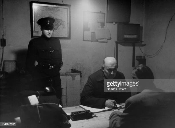 Head Constable Leslie Singer questions a suspect after an IRA raid at Lisnaskea Fermanagh Northern Ireland near the border with Eire Original...
