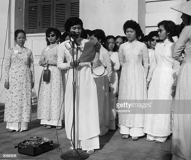 Miss LeThiHoa addresses the crowds at a mass meeting in Saigon to protest against Soviet intervention in Hungary and Communist aggression in North...