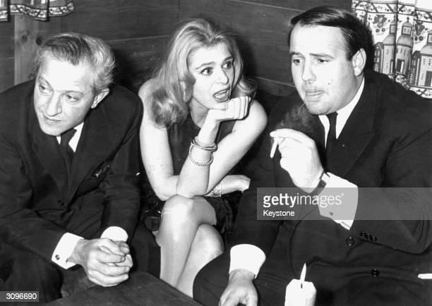 L to r Producer and director Jules Dassin Greek film star Melina Mercouri and Prince Sadruddin Khan at a party in Gstaad given by the Prince to...