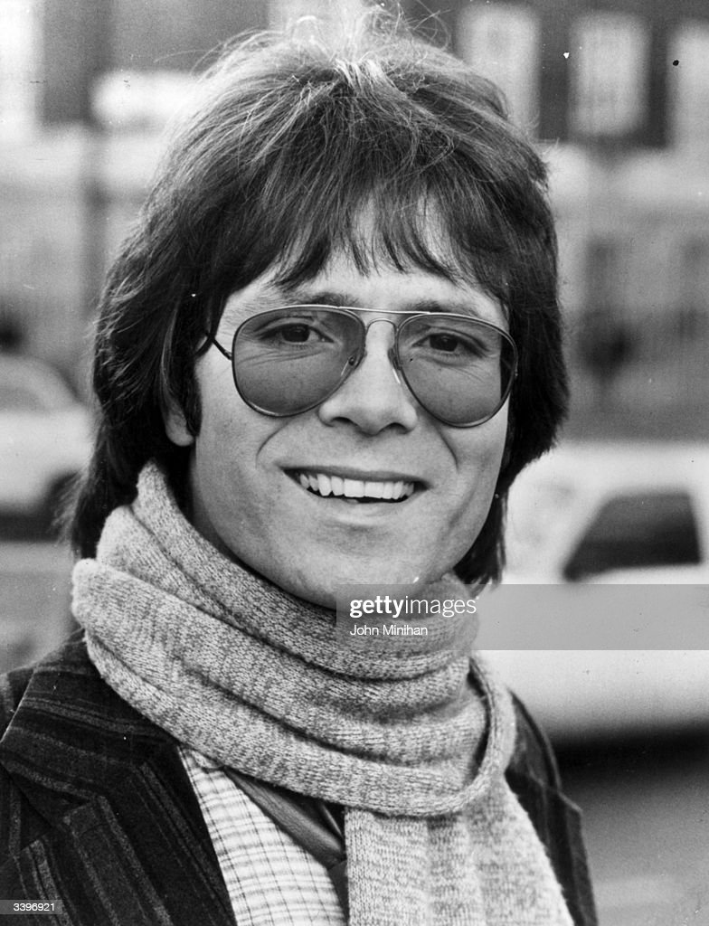 English pop singer Cliff Richard wearing a scarf.