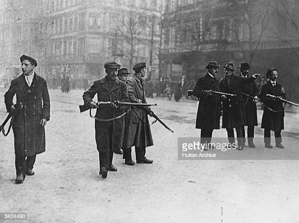 Communist Spartacist guards on the streets of Berlin during the uprising which followed Germany's defeat in World War I