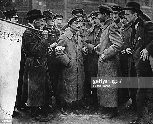 Spartacists and Government troops talking at an armistice conference during the Spartacist uprising which broke out in Berlin following Germany's...