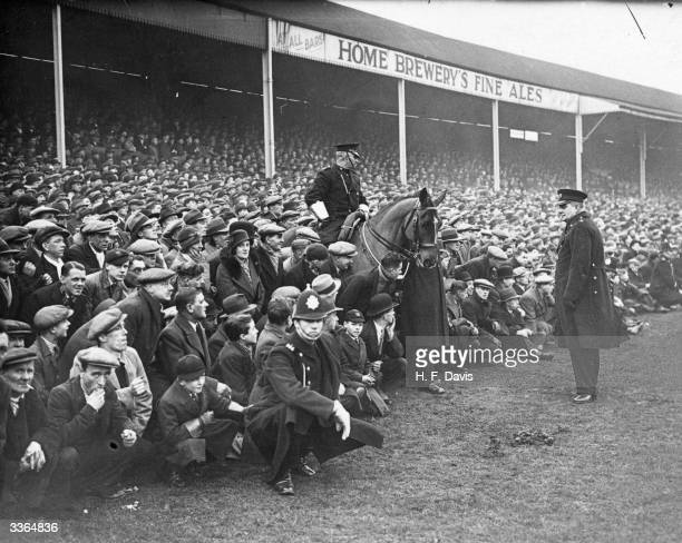Mounted policeman amongst the crowd overflowing onto the pitch for Nottingham Forest's FA Cup tie replay against Chelsea at Nottingham's 'City...