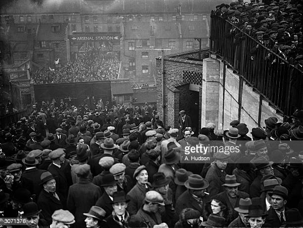 Spectators in the crush at Highbury ground in London when a huge crowd turned up for the Arsenal versus Tottenham Hotspur match