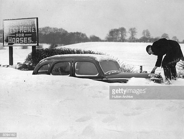 A car almost buried by snow near Macclesfield following the worst weather conditions for over a hundred years