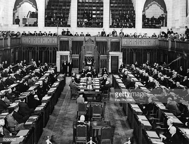The House Of Commons Chamber at Ottawa Canada with the Premiers of Canada's nine provinces and their advisors sitting at the conference table with...