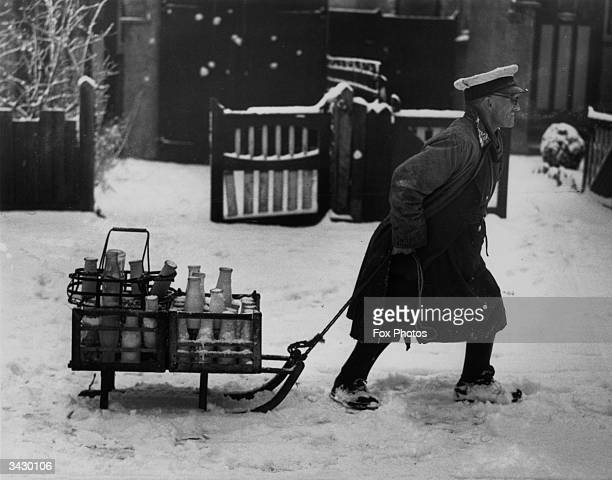 A milkman in Cheam Surrey pulling his deliveries through the snow on a sledge