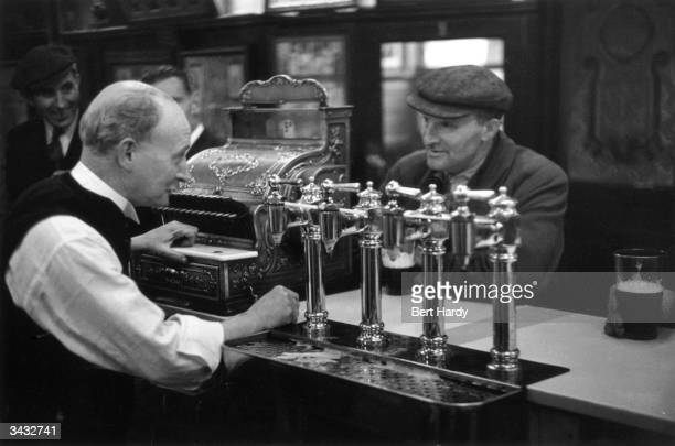 A barman at work in the Gorbals district of Glasgow The Gorbals tenements were built quickly and cheaply in the 1840s providing housing for Glasgow's...