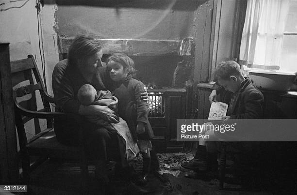 Family at home in the Gorbals area of Glasgow. The Gorbals tenements were built quickly and cheaply in the 1840s, providing housing for Glasgow's...
