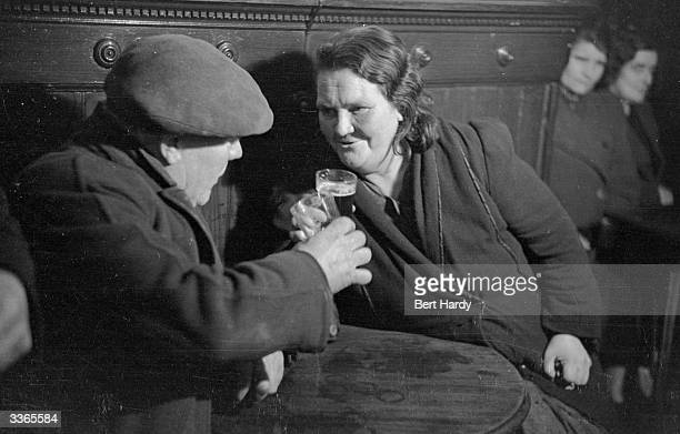 Glaswegians in a pub in the Gorbals at the time of this photograph there were 174 licensed establishments in the area The Gorbals tenements were...