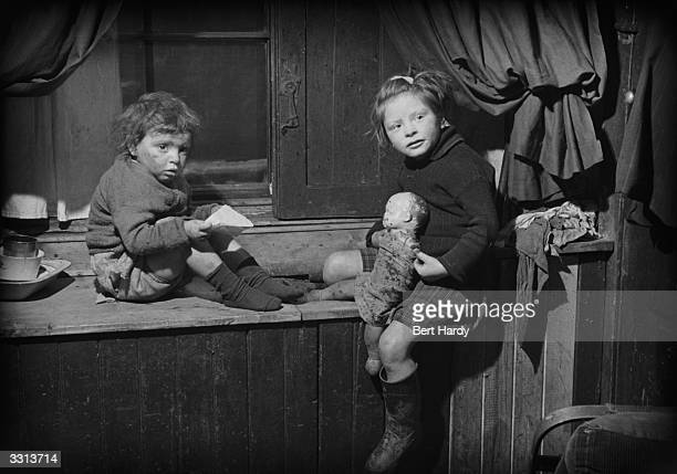 Two children at home in the Gorbals area of Glasgow The Gorbals tenements were built quickly and cheaply in the 1840s providing housing for Glasgow's...