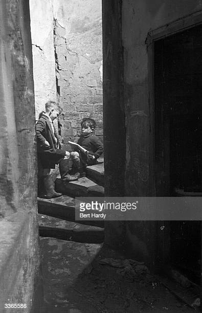 Two small boys on the stairs of flats in the Gorbals area of Glasgow The Gorbals tenements were built quickly and cheaply in the 1840s providing...