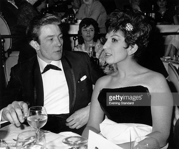 English actor Albert Finney with the singer Alma Cogan at the 'Talk of the Town' restaurant