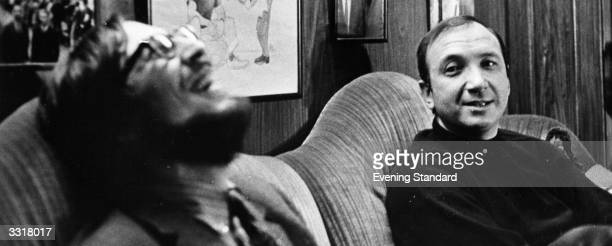 American playwright Neil Simon watching some one laughing at a joke