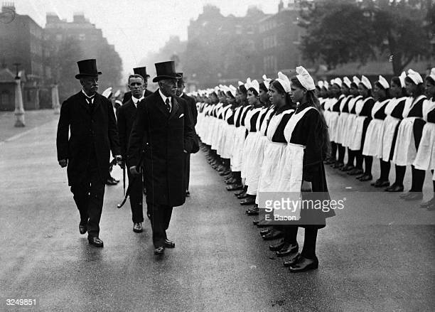 The Duke of Connaught visits the Foundling Hospital and inspects the girls following a drill display
