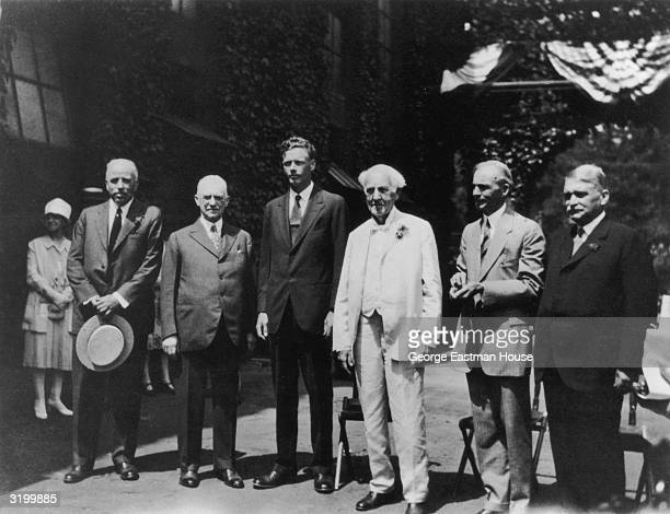 Portrait of the Edison Scholarship Committee standing outside the Edison Laboratories, West Orange, New Jersey. L-R: Dr. Lewis Perry, American...