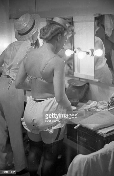 Girls backstage before the night's performance with one of France's most famous revue danceteams the Ballet Avila in a show at Alexandra Palace in...