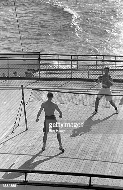 Playing volleyball on the deck of the Queen Elizabeth as it makes its way to Britain across the Atlantic America wants to see her European poor...