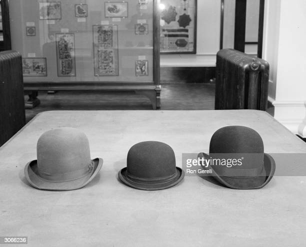 Three bowler hats on display at the Victoria and Albert Museum, London.