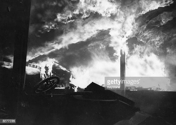 A storage shed burns fiercely during a riot at Lord Montagu of Beaulieu's jazz festival in the grounds of his stately home in Hampshire Teenage...