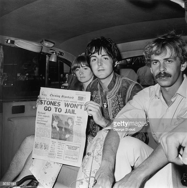 Paul McCartney of the Beatles and his girlfriend actress Jane Asher arrive at London Airport after a trip to Greece McCartney holds up an issue of...
