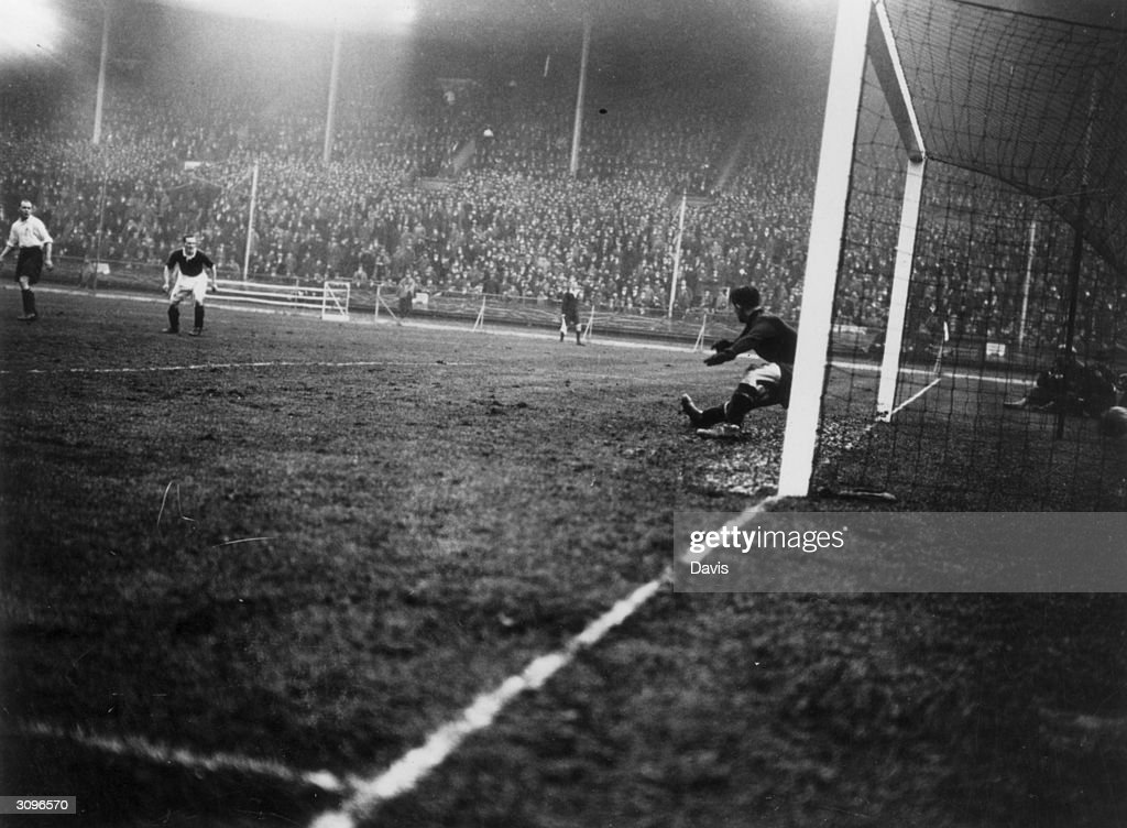 Goalkeeper Huyton is beaten by a shot from Jackson during the International soccer match between England and Scotland. The team was captained by Jimmy McMullan. Alex James scored twice and Scotland won the game 5 - 1.