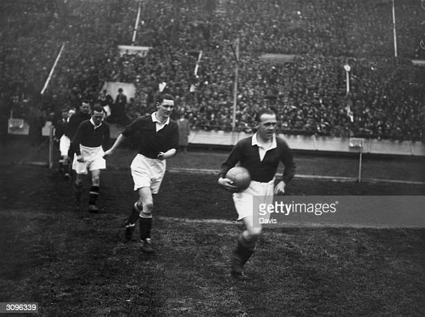 The Scottish captain Jimmy McMullan leads out his team for the International soccer match between England and Scotland Alex James scored twice and...