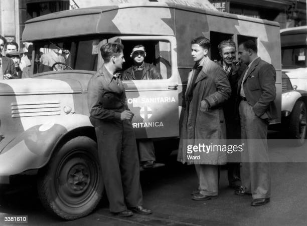 Members of a ambulance unit in London's New Oxford Street before they set off for Barcelona to help in the Spanish Civil War