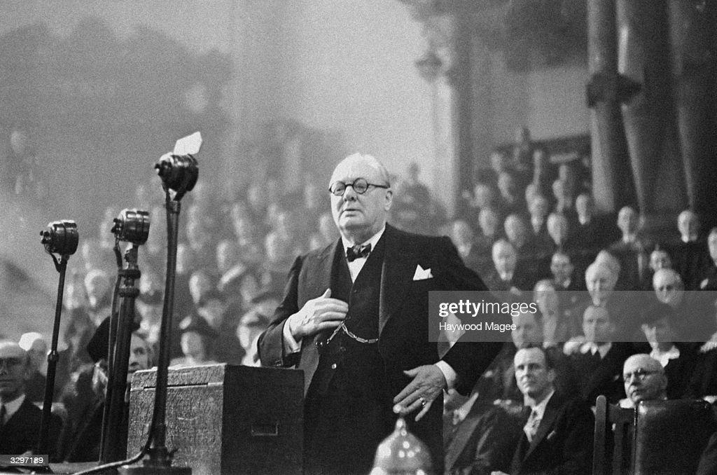 British statesman Sir Winston Leonard Spencer Churchill, (1874 - 1965), speaking at the Party Conference of the National Union of Conservative and Unionist Association, at Central Hall, London. Original Publication: Picture Post - 1934 - The Tories Arm For The Election - pub. 1945